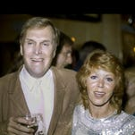 """Judy Carne and Alan Sues attend a """"Laugh-In"""" reunion party in 1983 in Los Angeles. Carne has died in a British hospital. She was 76."""