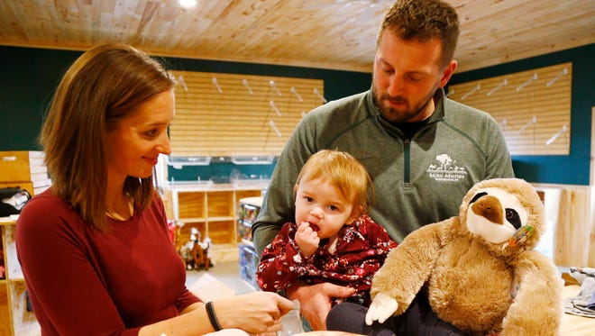 From left, Colleen, Ava and Jordan Patch inside the visitors center at Animal Adventure Park in Harpursville on Nov 13. Ava had brain surgery on Oct. 24 to correct a seizure disorder.
