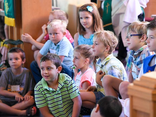 The future of the church listens to the children's message as the Centenary United Methodist Church on Old State Road celebrates its 150th anniversary Sunday, September 17, 2017.