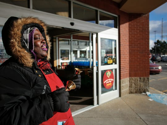 "Salvation Army bell ringer Anna Diamond sings ""Rudolph"