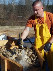 Oysters are rinsed and prepped for steaming at the