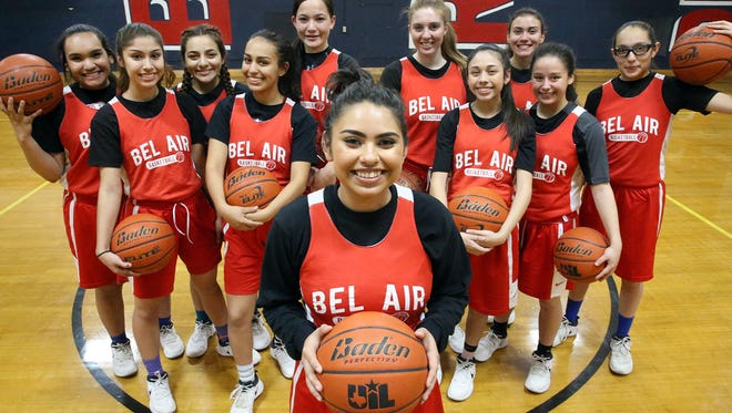 Audrey Likovic, foreground, triumphed over leukemia and rejoined her Highlander teammates.
