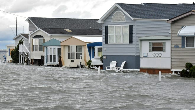 Homes in Warren's Park at 51st Street and Coastal Highway in Ocean City are surrounded by flood water pushed in from the Assawoman Bay in the aftermath of Hurricane Sandy on Oct. 30, 2012.