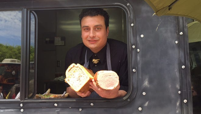 Nino Loreto stands in his food truck, Panino, during last year's Taste of Cincinnati with some of the charcuterie he makes.