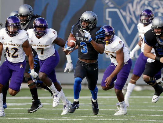 FILE - In this Nov. 25, 2017, file photo, Memphis wide receiver Anthony Miller (3) runs past East Carolina defenders as he scores a touchdown on an 89-yard pass play in the first half of an NCAA college football game, in Memphis, Tenn. Wide receiver Anthony Miller came to Memphis as a local preferred walk-on. Quarterback Riley Ferguson started at the Southeastern Conference school on the other side of the state before Mike Norvell lured him to town. Together, they've helped the 16th-ranked Tigers reach the American Athletic Conference championship against No. 12 UCF with a chance at the program's best season ever.(AP Photo/Mark Humphrey, File)