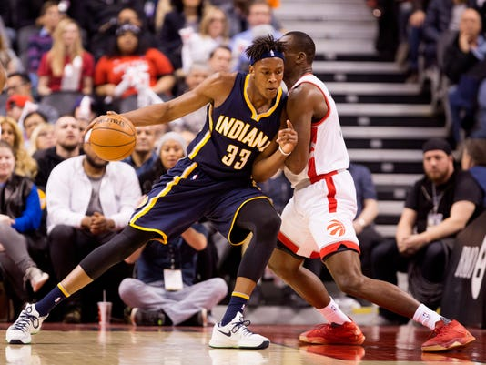 Indiana Pacers forward Myles Turner (33) bumps Toronto Raptors center Bismack Biyombo (8) during the first half of an NBA basketball game in Toronto on Friday, April 8, 2016. (Peter Power/The Canadian Press via AP) MANDATORY CREDIT