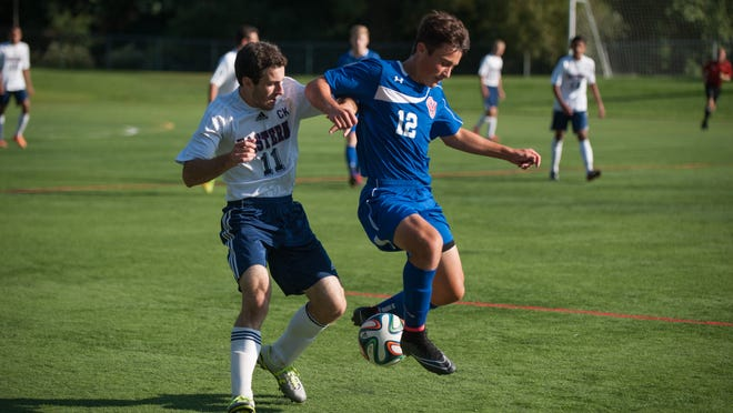 Eastern's Tommy Katsaros (left) and Lou Vilotti of Washington Township battle for control of the ball during Wednesday's Olympic American game.