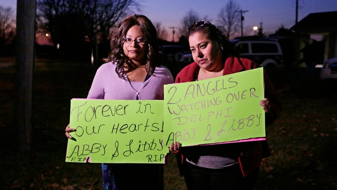 Nallely Garcia-Nava, left, and Yolanda Cruz showed their signs of support for Abigail Williams and Liberty German down the street from the visitation at Delphi Community High School on Saturday, Feb. 18, 2017.