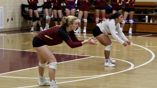 Cardinal Spellman High volleyball player Mary Lysko gets in position to return a serve against Fontbonne Academy on Wednesday, Oct. 23, 2019.