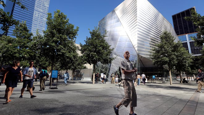 A visitor to the National September 11 Memorial and Museum takes in the sight as he walks past the museum in New York on Sept. 6, 2013.