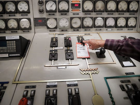 A.C. Cox, 85, talks about some of the changes in technology he saw at the Allen Fossil Plant as he stands over the control panel he used to officially shut down the plant in April 2018. Cox began working at the plant just after its completion in 1959.