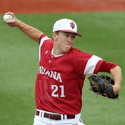 Indiana University's Christian Morris (21) pitches in the first inning during the NCAA regional baseball game Sunday, June 1, 2014, evening at Bart Kaufman Field in Bloomington IN.