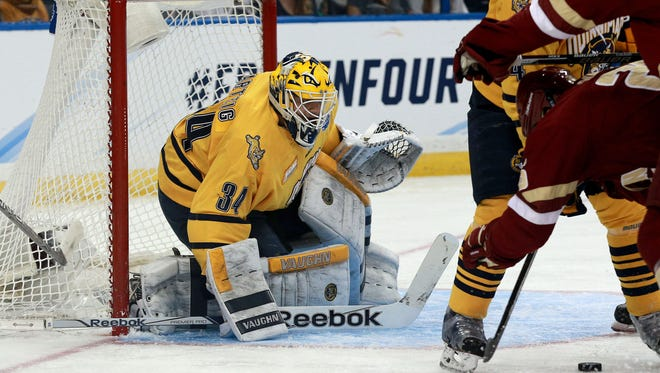 Quinnipiac Bobcats goalie Michael Garteig (34) makes a save against the Boston College Eagles during the first period of the semifinals of the 2016 Frozen Four.