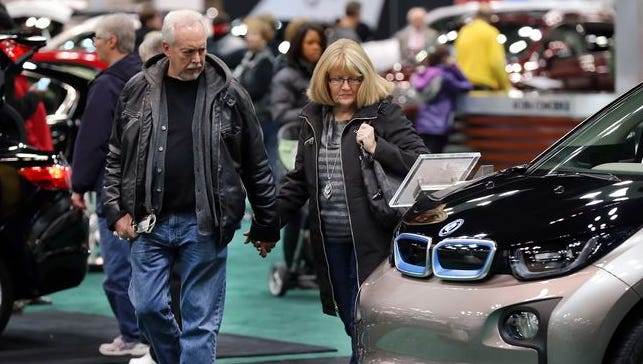 People take in all the newest cars during the 100th Indianapolis Auto Show onDec. 26, 2013,at the Indiana Convention Center, Indianapolis.