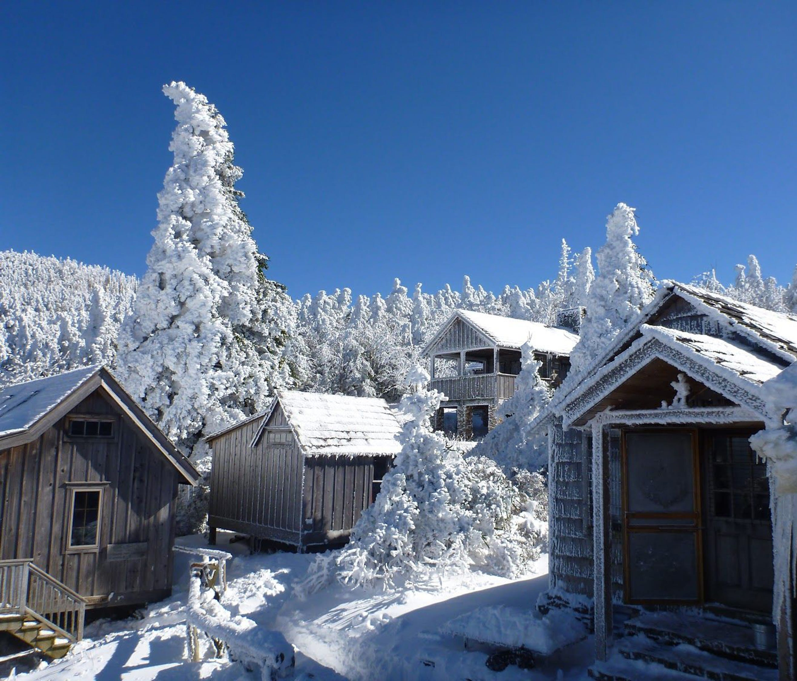 Snow blankets much of LeConte Lodge and its surrounding cabins on Mount LeConte in 2012 in the Great Smoky Mountains National Park near Gatlinburg, Tenn.