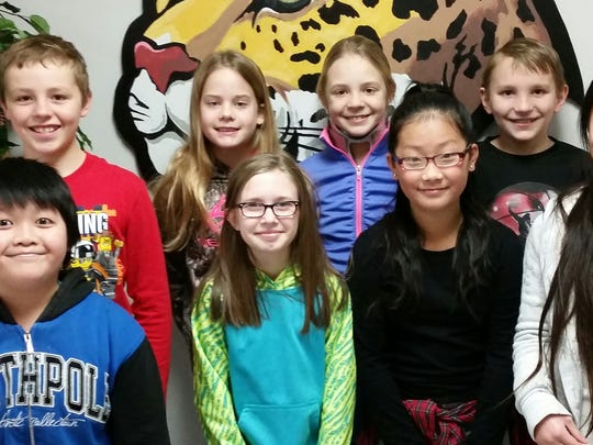 The students who spelled all the challenge words correctly, pictured in the front row, from left, are Senkeo H., Lily M., Emily L. and Lisa L., and in the back row from left, Luke S., Mallory W., Allison R. and Nick R.