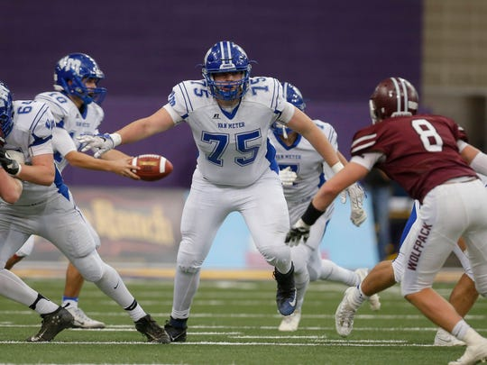 Van Meter offensive guard Sean Boles helps create running room against Western Christian during the semifinals of the 2016 Iowa high school football tournament on Saturday, Nov. 12, 2016, at the UNI-Dome in Cedar Falls.