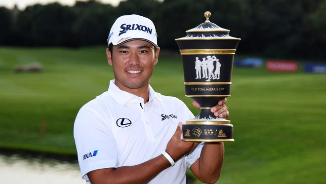 Hideki Matsuyama with the winners trophy at the Sheshan International Golf Club in Shanghai.