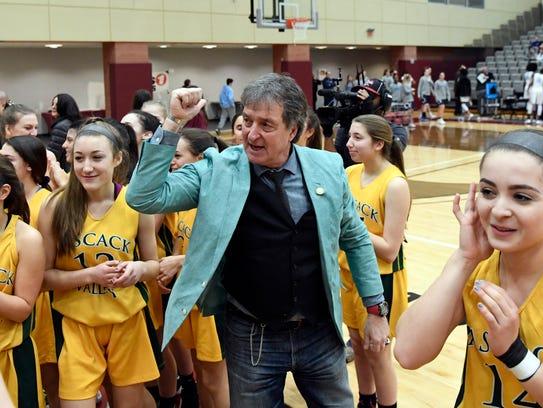 Pascack Valley head coach Jeff Jasper celebrates his