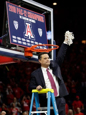 Arizona coach Sean Miller holds up the net after Arizona won the Pac-12 regular-season title, following an NCAA college basketball game against California, Saturday, March 3, 2018, in Tucson, Ariz. Arizona defeated California 66-54. (AP Photo/Rick Scuteri)