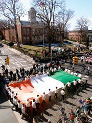 Morristown, Mar 10--The Friendly Sons of Saint Patrick carry a giant Irish flag down Washington St during the St Patricks Day ParadePhoto/BKarp