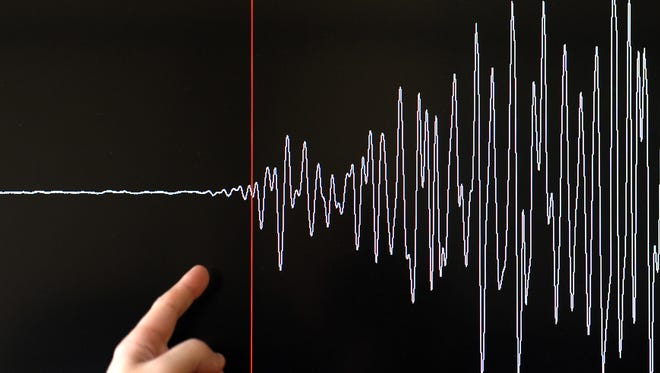A technician of the French National Seism Survey Institute (RENASS) presents a graph on March 11, 2011 in Strasbourg, Eastern France, registered today during a major earthquake in Japan. A 8.9 magnitude quake hit northeast Japan today, causing many injuries, deaths, fires and a tsunami along parts of the country's coastline.  AFP PHOTO / FREDERICK FLORIN (Photo credit should read FREDERICK FLORIN/AFP/Getty Images)
