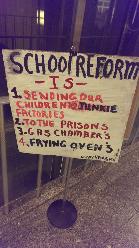 Community activist and Indianapolis mayoral candidate Larry Vaughn raised a stir, when he left a sign outside the City-County Council chambers on Monday night that compared school reform efforts to gas chambers and ovens in an apparent reference to the Nazi Holocaust.
