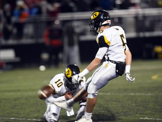 Chase Dinan kicks a game-tying field goal with five