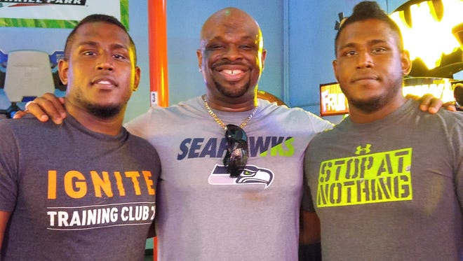 Pro wrestler D-Von Dudley and his sons Terrence and Terrell (T.N.T.). Terrence and Terrell have followed in their famous father's footsteps.