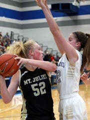 Mt. Juliet's Emma Palmer is blanketed by Wilson Central's
