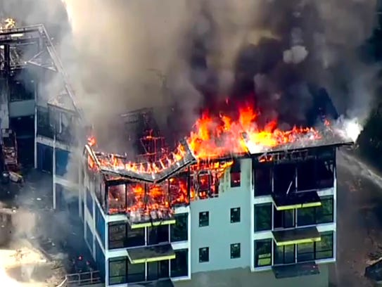 Yonkers firefighters battle heavy smoke and fire at a Ginsburg Cos. apartment building under construction in May.
