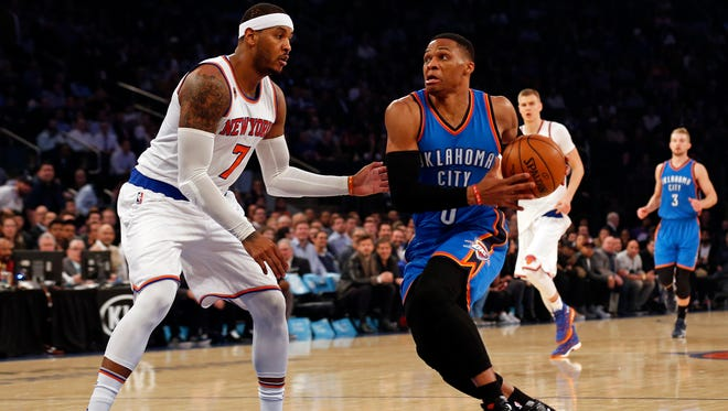 Oklahoma City Thunder guard Russell Westbrook (0) drives to the basket past New York Knicks forward Carmelo Anthony (7) during the first quarter at Madison Square Garden.