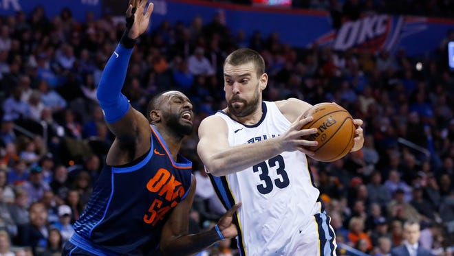 Memphis Grizzlies center Marc Gasol (33) drives past Oklahoma City Thunder forward Patrick Patterson (54) in the first half of an NBA basketball game in Oklahoma City, Sunday, Feb. 11, 2018. (AP Photo/Sue Ogrocki)