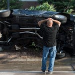A Ford Mustang was involved in an accident that left the vehicle on its side on W. Drake Rd. near the intersection of Constitution Ave. Thursday, July 2, 2015.