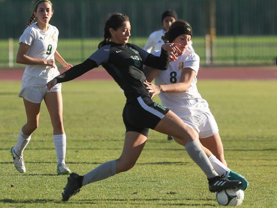Miranda Torres of Coachella Valley fights for a loose ball against San Gabriel Mission, February 27, 2018.
