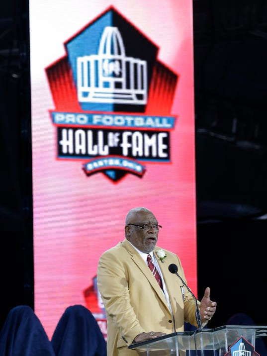 Hall of Fame inductee Claude Humphrey speaks during the Pro Football Hall of Fame enshrinement ceremony Saturday, Aug. 2, 2014, in Canton, Ohio. (AP Photo/Tony Dejak)