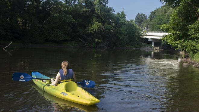 Heather Hawthorne, of Akron, was in a kayak at the Middlebury entrance in Kent of the Cuyahoga River. The river has been lower this year, encouraging new enthusiasts to try the sport.