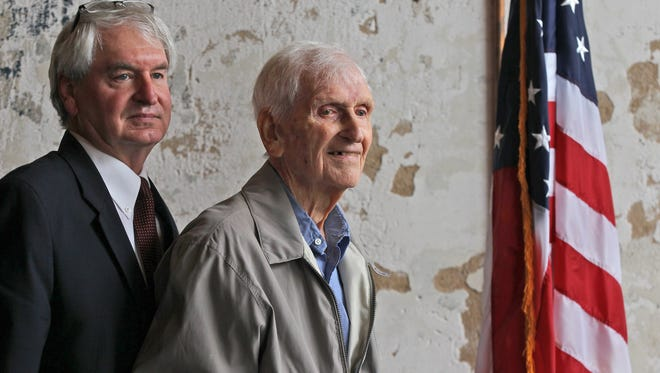 Carey Jones, Jr. (left) and Carey Jones, Sr. (right) of Anderson, after a Veteran's Day Program by the Rotary Club of Anderson at the Bleckley Inn in Anderson in 2015. Jones, Sr. was a prisoner of war for a year serving with the U.S. Army Air Corps during World War II, where he was a gunner and engineer in a B-17 bomber.