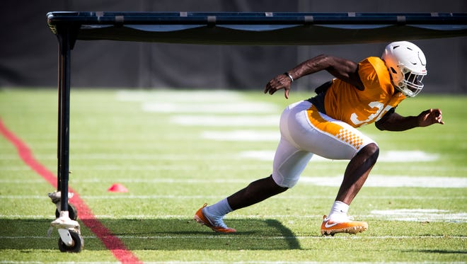 Tennessee linebacker Daniel Bituli (35) participates in a drill during football practice at the University of Tennessee on April 17, 2018.