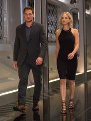 Jim (Chris Pratt) and Aurora (Jennifer Lawrence) have