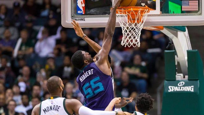 Charlotte Hornets center Roy Hibbert dunks as Milwaukee Bucks center Greg Monroe  and guard Rashad Vaughn look on during the third quarter.