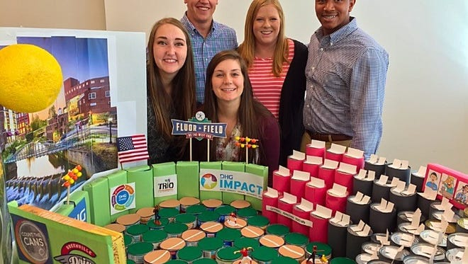 DHG interns built a model of Fluor Field out of the collected cans