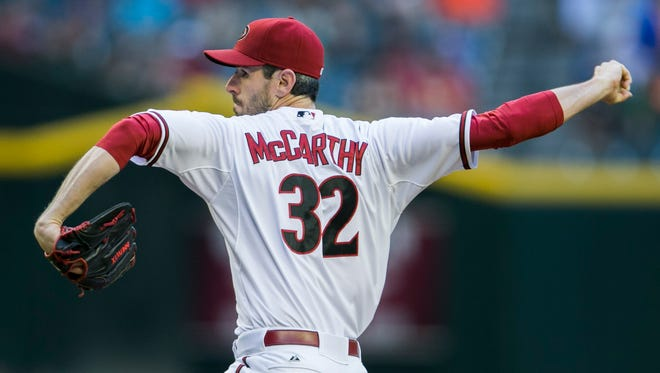 Diamondbacks' Brandon McCarthy pitches in the first inning against the Brewers at Chase Field in Phoenix on Monday, June 16, 2014.