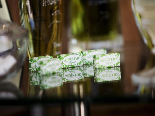 Sugar cubes are used in preparing a glass of Absinthe.