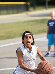 A camper participates in basketball drills at the ADHD