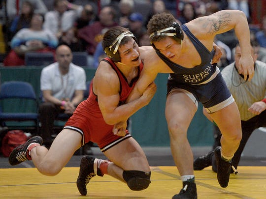 Hilton's Louie DePrez, left, wrestles against Hauppauge's Marcus Bisono-11 in the finals of the 170-pound class (Division I) during the NYSPHSAA 2016 State Wrestling Championships held at the Times Union Center in Albany, N.Y. on Saturday, Feb. 27, 2016.