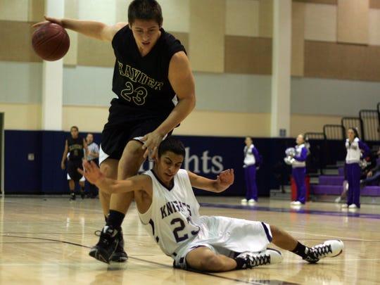 Xavier Prep's Brandon Vandenburg, gets control of the ball against Shadow Hills High School in Indio on Nov. 30, 2010.