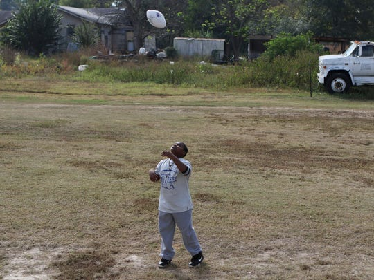 """Deangelo Brown Jr., 11, tosses a football given to him by Louisiana Tech running back Jaqwis Dancy outside his grandmother's home in Ruston on Friday, November 4, 2016. The autographed ball reads, """"Keep fighting never give up on your dreams."""" Brown is undergoing treatment for Hodgkin's lymphoma at St. Jude's Children's Research Hospital in Memphis. Dancy also receives treatment for the same cancer there."""