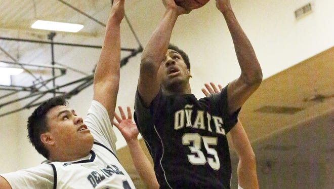 Oñate's Johnny McCants, 35, rises for a shot against Del Valle's Jesse Arroyo, 34, Wednesday at Austin High School. Del Valle prevailed 51-46.