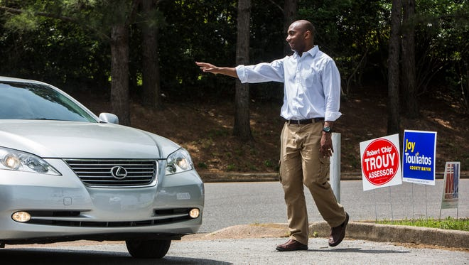 May 1, 2018 - Democrat Lee Harris, who's running for Shelby County Mayor, waves to a driver entering Shady Grove Elementary School on Election Day on Tuesday.